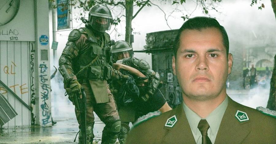 El Teniente Coronel Carlos Guzmán Crespo, sosteniendo una escopeta en la imagen.