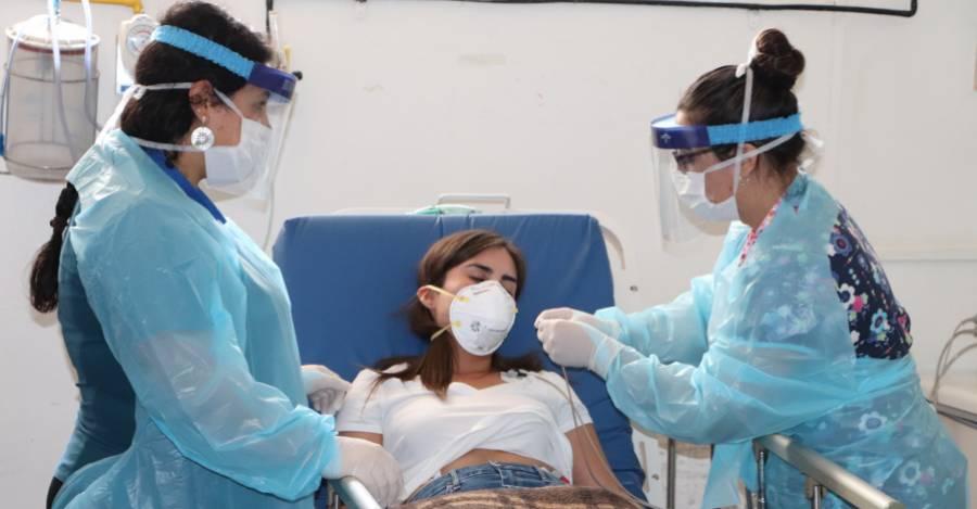 Fotografía referencial. Simulacro de paciente con Covid-19, Minsal